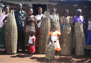 HA_Community members with traditional bee hives to be placed in Empaako forests