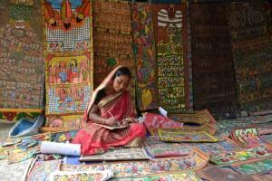 Patua woman   showcasing her work